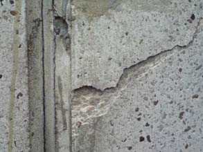 Cracked concrete chimney stack